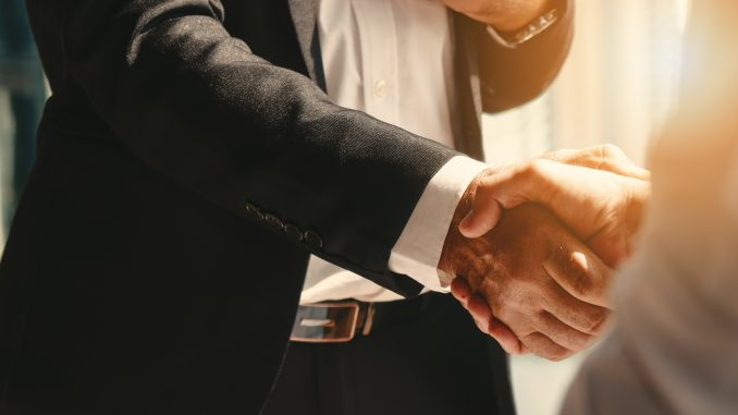 business background of businessman having handshake